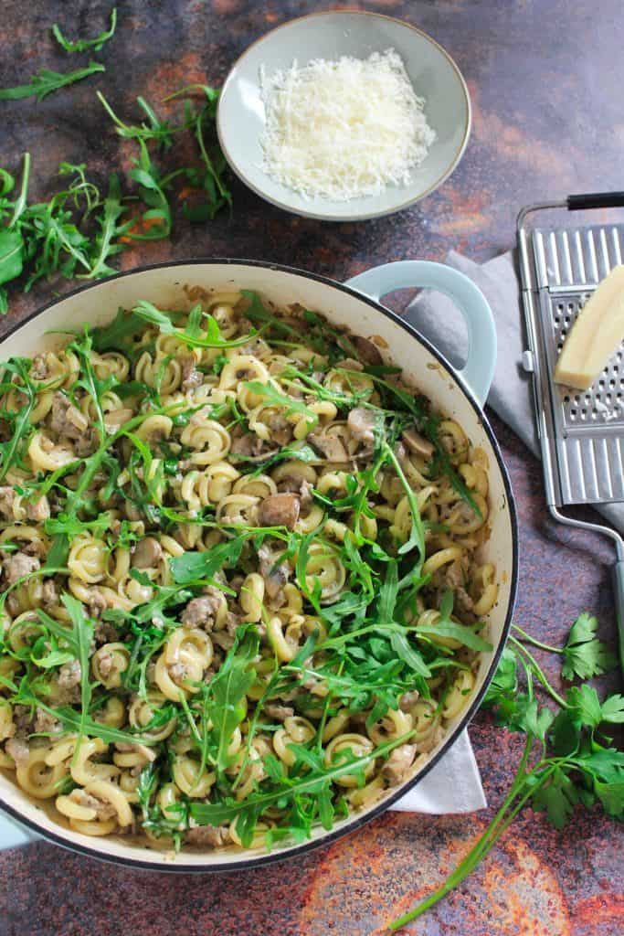 sausage and mushroom pasta with arugula