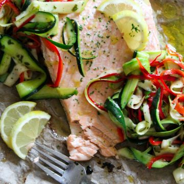 Super easy oven baked lemon Salmon fillet with a fresh Courgette and Pepper salad - the perfect light summer meal in under 30 minutes!