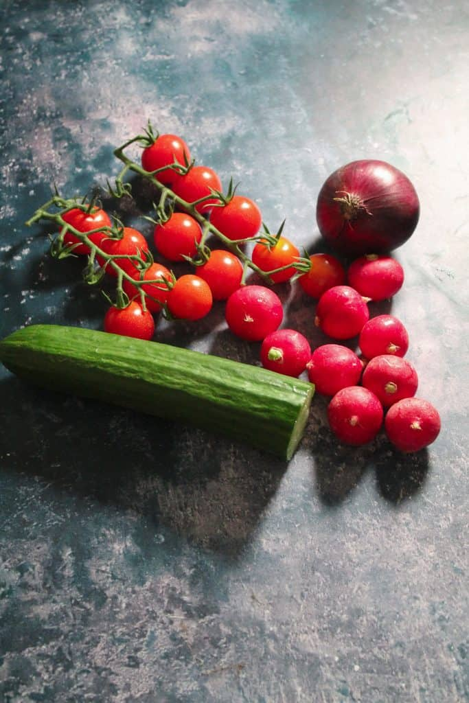 Tomatoes, cucumber, radishes and red onion