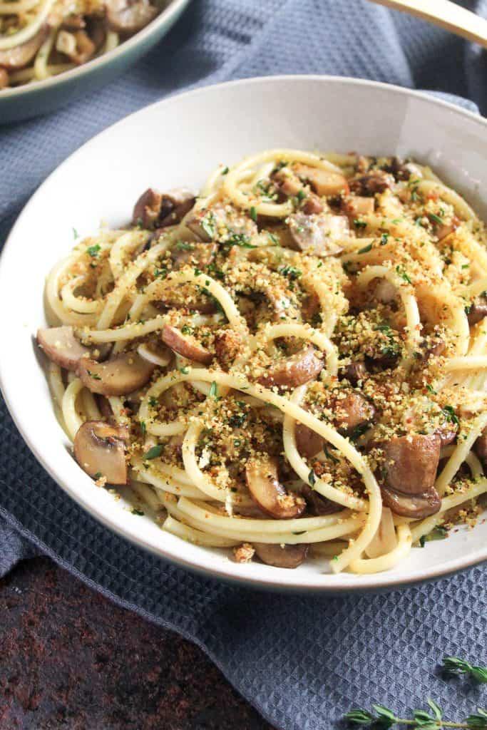 Vegan Garlic Mushroom Spaghetti topped with herby breadcrumbs