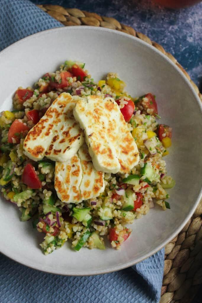 Close up shot of halloumi and bulgur wheat salad.