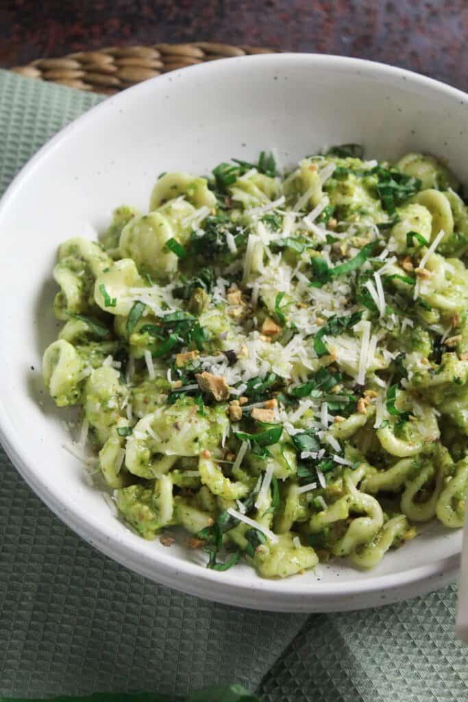 Close up of pistachio pesto tossed with orecchiette pasta.