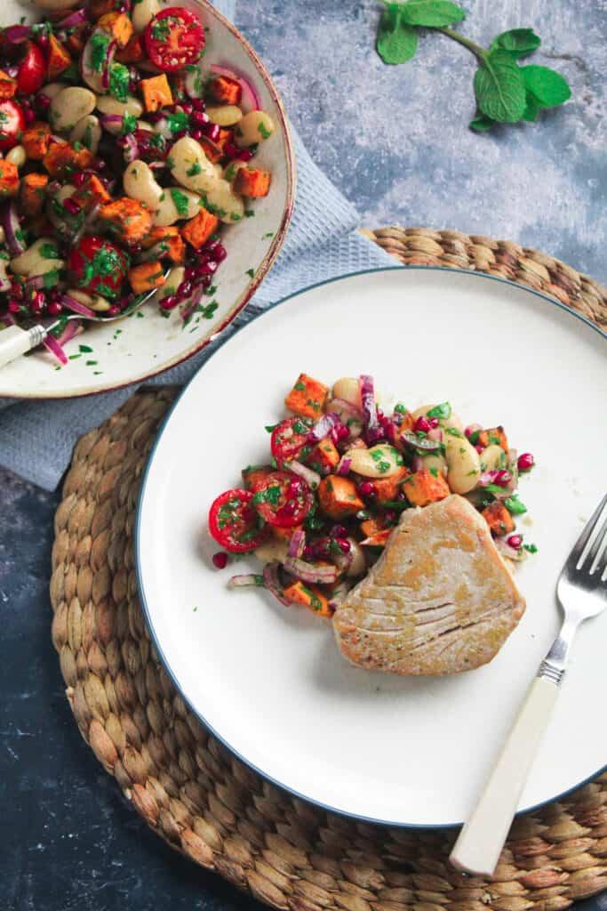 One pan seared tuna steak on a bed of roast sweet potato salad.